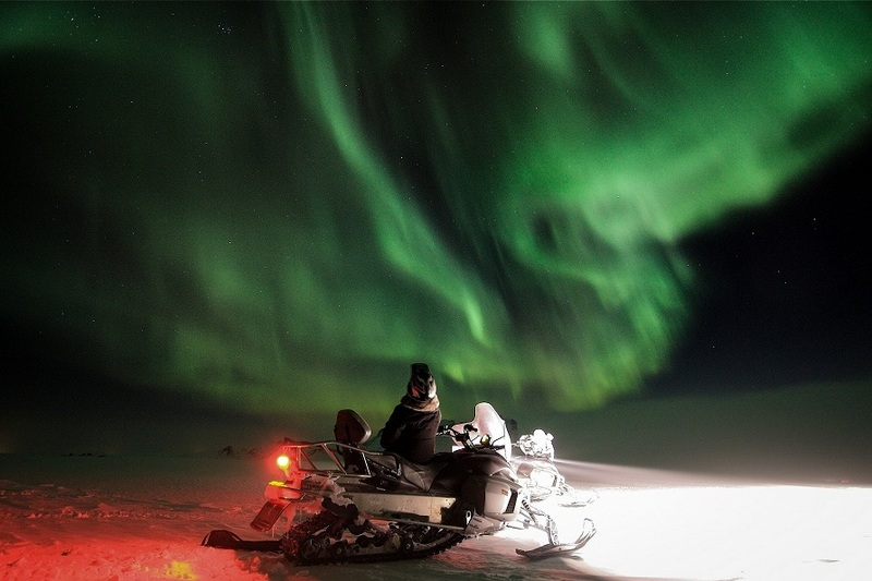 northern lights chase by snowmobile in Iceland.jpg