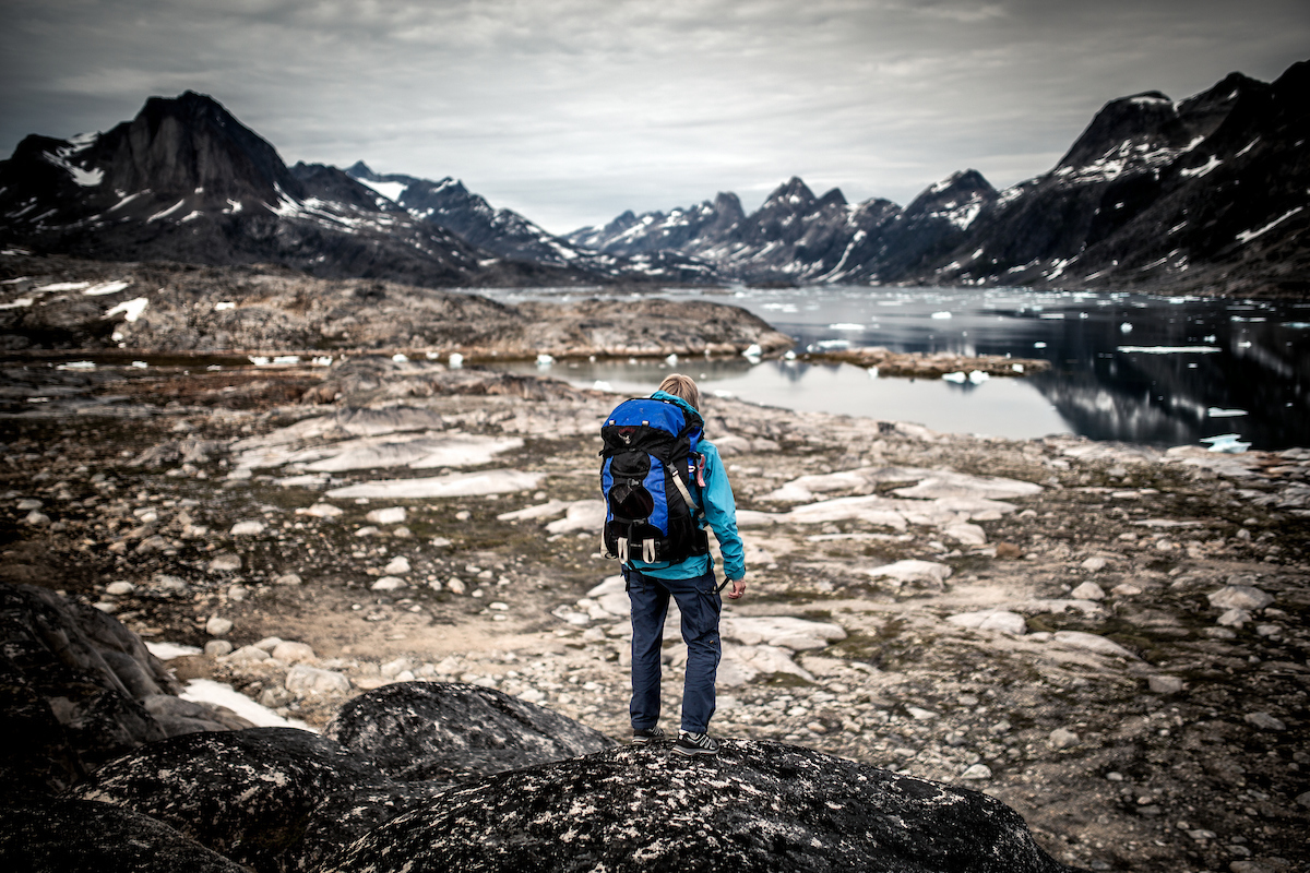 A hiker near Tasiilaq looking into Ikaasatsivaq Sound in East Greenland.jpg