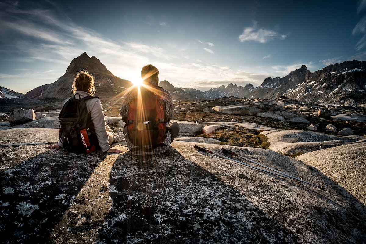 Two hikers enjoying the sunset near Qenertivartivit in Ammassalik Fjord near Kulusuk in East Greenland.jpg